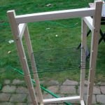 Frame showing slots for racks