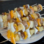 Prepared jerk pork kebabs with pineapple