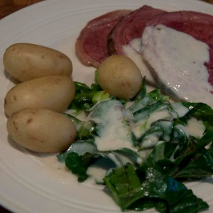 Salt beef with potatoes and spring greens