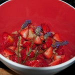 Layering lavender with sugar and strawberries.