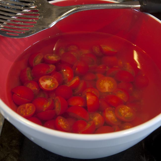 Tomatoes soaking in acidulated water