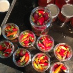Pack chillies in jars